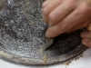 Opération de décroutage du plateau du polissoir
